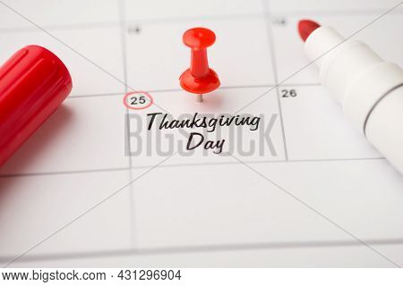 Closeup Photo Of Mark On Calendar At Twenty-fifth Inscription Thanksgiving Day With Red Pushpin And