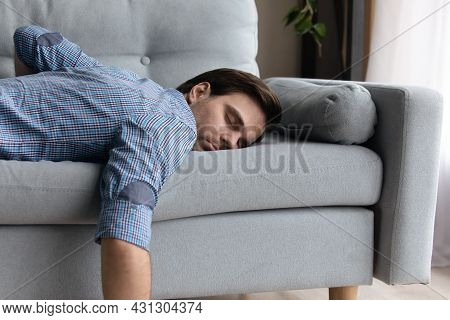 Tired Millennial Guy In Casual Sleeping At Daytime