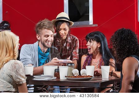 Friends Looking At Text Messages