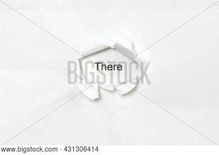 Word There On White Isolated Background, The Inscription Through The Wound Hole In Paper. Concept Of