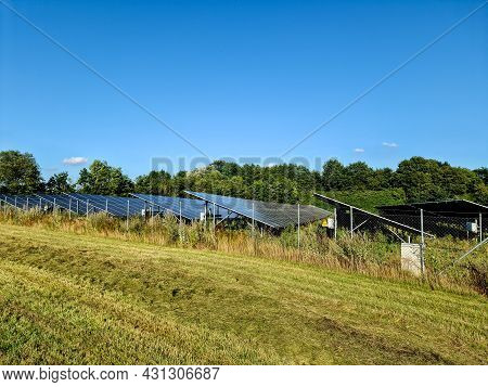 Generating Clean Energy With Solar Modules In A Big Park In Northern Europe