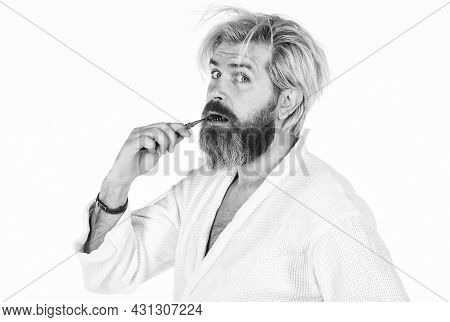 Stay Healthy. Keep Teeth Healthy. Brush Teeth. Morning Routine. Oral Hygiene. Mature Man In Bathrobe