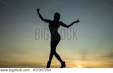 Rise Of Inspiration. Woman Silhouette On Evening Sky. Inspirational Figure. Inspiration