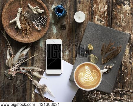 Rustic Wooden Background With Boho Chic Style Decorations: Dreamctcher, Cup Of Cappuccino, Notebook