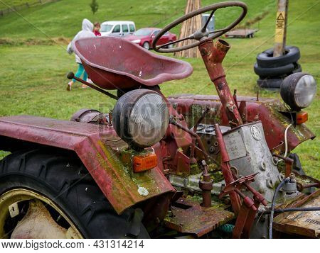 Valea Rece, Romania- 29 August 2021: Old , Abandoned Tractor On The Field, Focus On The Headlight.