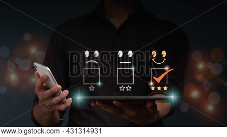 The Businessman Hold A Tablet Computer With Smile And 3 Stars Icon For Customer Services Best Excell