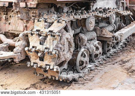 Bulldozer Crawler Machine Close-up. Powerful Bulldozer Tracks. Construction Machinery For Land Level