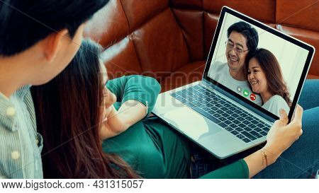 Family Happy Video Call While Stay Safe At Home During Covid-19 Coronavirus Outbreak. Concept Of Peo