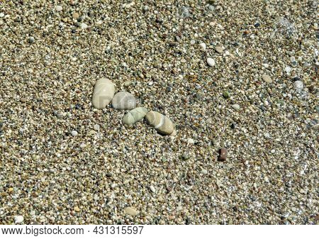 Multi-colored Pebbles On The Shores Of The Mediterranean Sea. Pebble Background. Coast. Abstract Bac