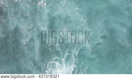 Flying Over The Ocean At The Golden Hour. Giant Waves Foaming And Splashing In The Ocean. The Turquo