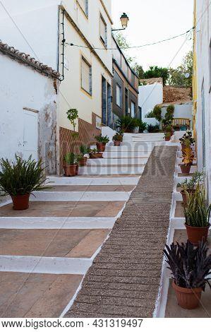Beautiful Street At Alvor. White Houses, Pots With Plants. Portimao, Algarve, Portugal, Europe