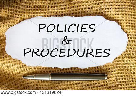 Policies And Procedures Symbol. Words 'policies And Procedures' On White Paper. Black Metallic Pen.