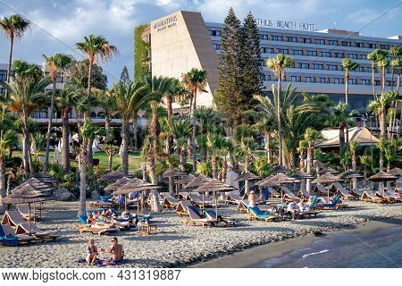Limassol, Cyprus - June 24, 2019: People Relaxing On The City Beach Near Famous Amathus Hotel
