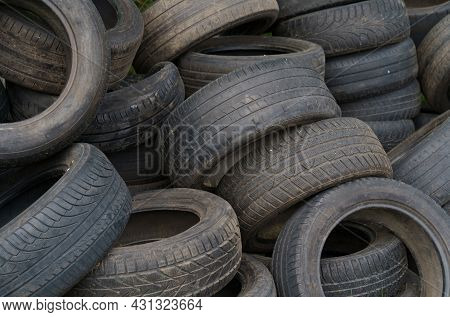 Ecology Concept. Dump Of Old Car Tires, Texture. Close-up