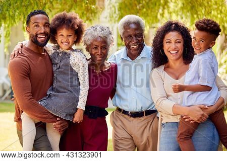 Portrait Of Smiling Multi-Generation Family At Home In Garden Together