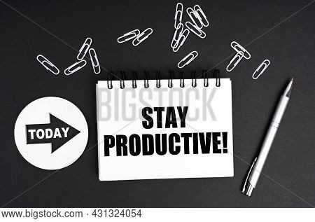 Business Concept. On A Black Background, A Round Plate - Today And A Notebook With The Inscription -