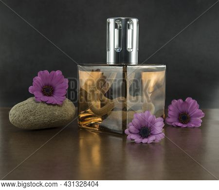 Exclusive Golden Coloured Parfum In Glass Bottle Woth Ze Setting With Spanish Daisy Flowers And Stac