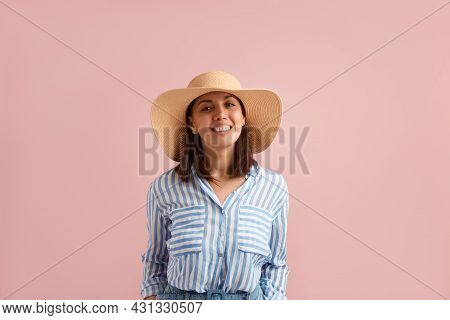Smiling Happy Positive Woman With Dark Hair Is Going On Vacation, Ready To Pack Bags, Tries On Straw