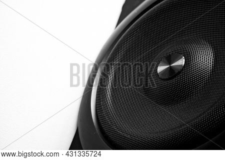 Black Audio Speaker With Metal Grille On A White Background. Concept For Audio Technology, Music, Au