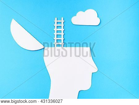 Uplifting Concept, Paper Cut Open Head With Ladder Up To The Cloud