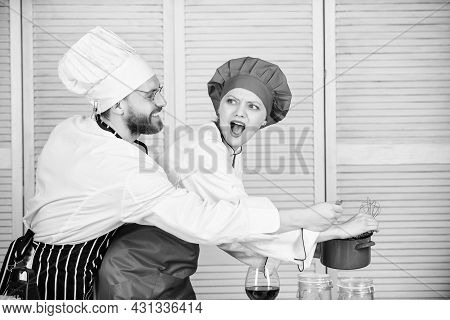 Woman And Bearded Man Chef Cooking Together. Delicious Meal. Baking Pie Together. Cooking Together I