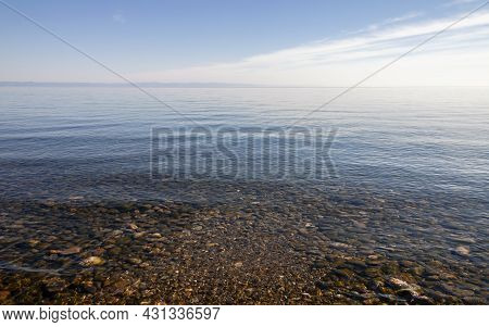 Landscape With Clear Fresh Water And A Panorama Of Lake Baikal On A Summer Day. The Transparent Surf