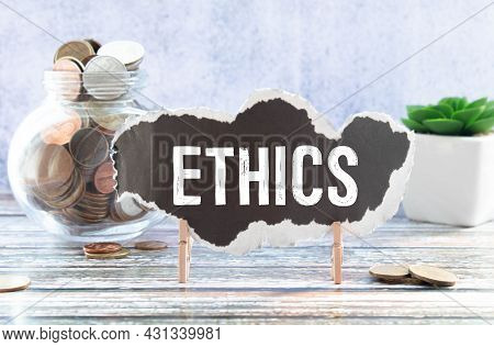 Torn Paper With Word Ethics, Business Concept