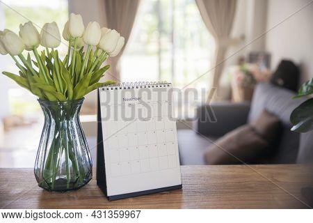 Calendar Desk And Flower On Table In Living Room. Desktop Calender For Planner To Plan Agenda, Timet
