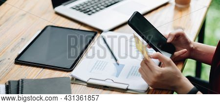 Woman Using Credit Card And Mobile Phone For Online Shopping And Internet Payment Via Mobile Banking