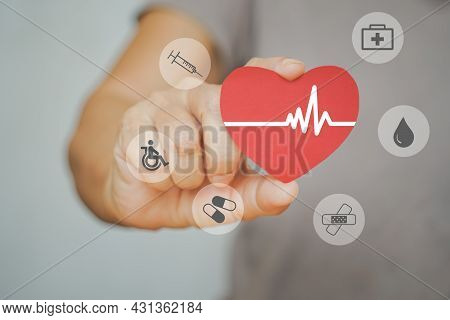 Human Hand Holding Red Heart Paper With Heartbeat And Other Medical Icon,  Health Checking, Health M