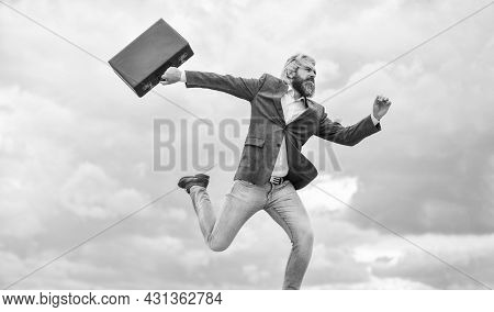 Freedom And Success. Feeling Free And Lucky. Successful Businessman Jump High With Money Case. Real