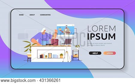 Senior Woman Preparing Dish While Watching Video Tutorial With Female Chef In Web Browser Window Onl