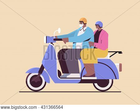 Senior African American Couple In Helmets Driving Scooter Grandparents Traveling On Moped Active Old