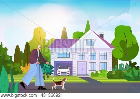 Active Senior Man Walking In With His Little Dog Grandfather Relaxing With Pet Near Cottage House Ho