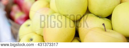 Many Yellow And Red Apples Lying In Shop Window Closeup