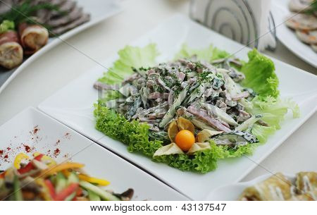 side dish with cabbage, cucumber, bacon