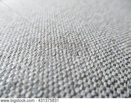 Macro Shot Of Gray Upholstery For Furniture. Selective Focus Of Gray Textured Fabric With Copy Space