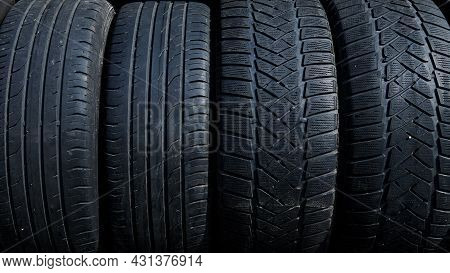 Stack Of Used Tires At The Car Service Waiting For Disposal. Worn Out Rubber Tires At The Car Tire F