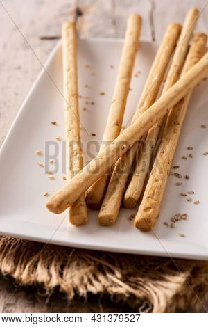 Breadstick Grissini Snack On Rustic Wooden Table