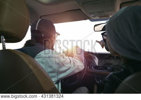 Asian Couple Looking At View While Traveling By Car