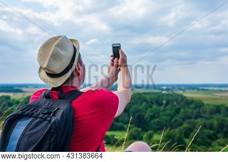 Young Backpacker Man Taking Selfie Picture Using Smartphone.cloudy Sky Weather Mountain Summer Range
