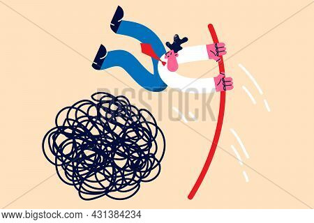 Business Challenge And Leadership Concept. Young Positive Businessman Jumping With Stick Over Messy