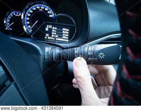 Close-up (eye-level Angle). Asian Hand (thumb), Using Turn On The High Beam Headlights (in Car), Ban