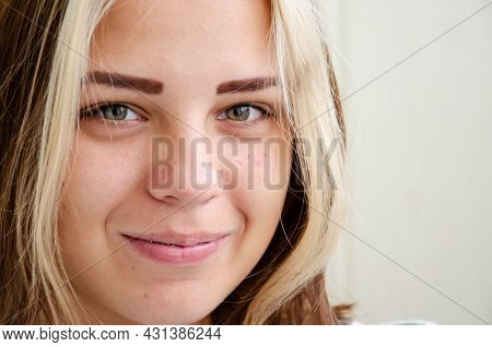 Pretty Caucasian Young Girl With Green Eyes Looks At Camera And Smiles. Brunette Teen Girl In Dental
