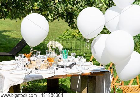 Festive White Table Setting In The Backyard Garden. Summer Childrens Party, Garden Party, Real Domes