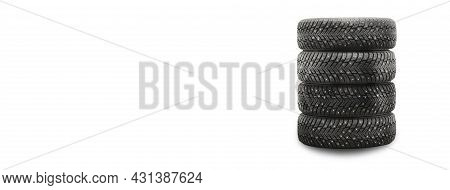 Winter Studded Tires Isolate Product Four Pieces Stack On A White Background With Copyspace