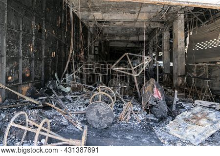 A Burnt-out Cafe In Thailand, Insurance Of Premises Against Fire. Burnt Furniture And Chairs. An Acc
