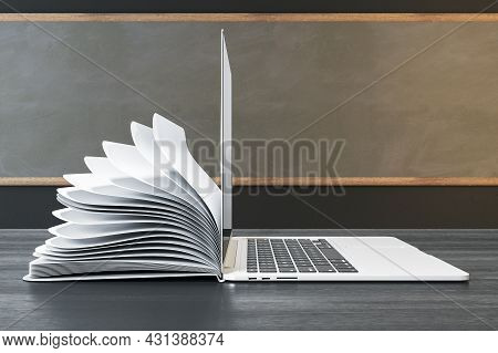 Side View Of Notepad And Notepad Put Back To Back On Classroom Desktop With Chalkboard Background. O