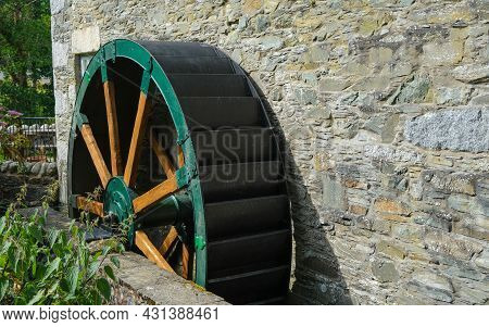 Green Wooden And Metal Water Wheel At The Old Cotton Mill On The Water Of Fleet At Gatehouse, Dumfri