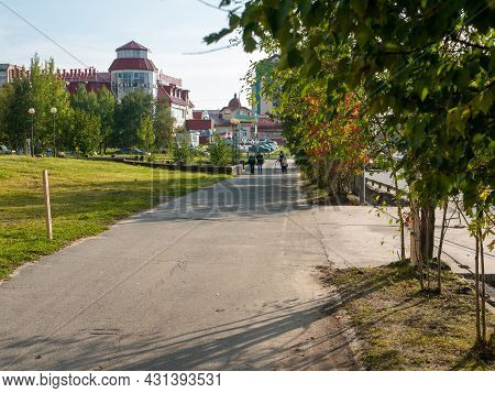 Noyabrsk, Russia - August 30, 2020: People Walk Along The City Path In The City Center. An Alley Wit
